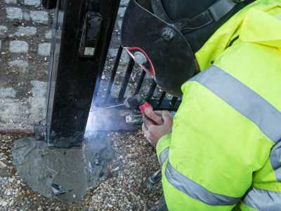 electric gate being repaired