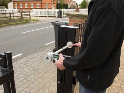 strand systems engineer installing gate