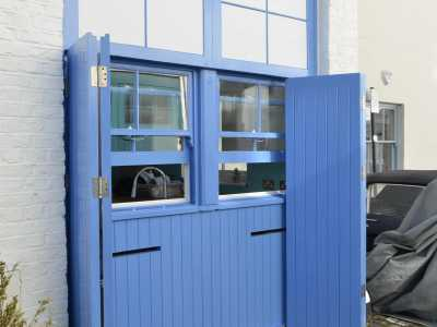 Mews property swing doors to reveal downstairs windows