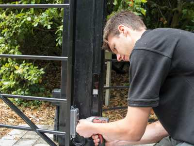 electric gate being serviced by engineer