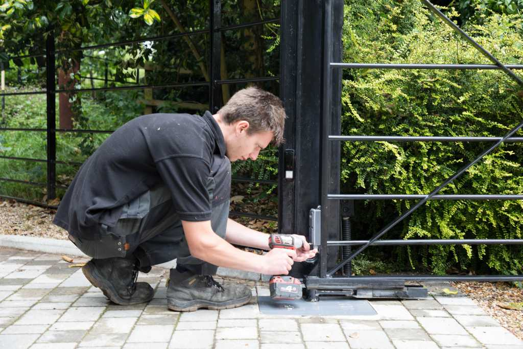 Automated gate being serviced