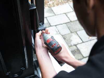 Domestic electric gate being serviced